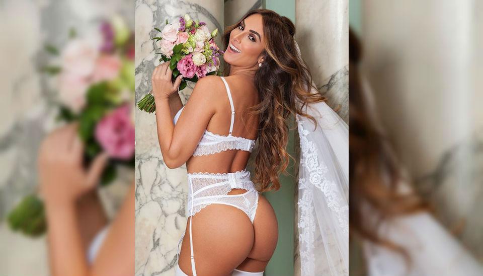 Nicole Bahls encarna noiva sexy em ensaio de lingerie. A modelo, que emagreceu recentemente sete quilos, está prestes a subir ao altar na vida real com Marcelo Bimbi