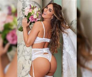 Nicole Bahls posa de noiva sexy em ensaio de lingerie após emagrecer sete quilos