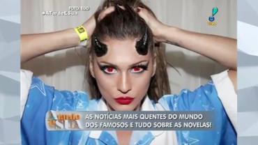 Com lentes vermelhas, L�via Andrade d� show em avenida e conquista mais f�s
