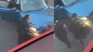 Mulher fica presa entre dois carros após ser atropelada de propósito; vídeo