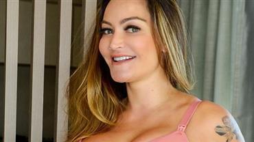 """De lingerie, Laura Keller posa com cinta em barrigão de grávida e seguidor critica: """"Crescer livre"""""""