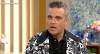 Cantor Robbie Williams tenta explicar gesto obsceno na abertura da Copa