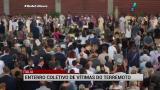 It�lia realiza enterro coletivo de v�timas de terremoto