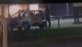 PM suspeito de estupro entra no banco de trás da viatura com a vítima