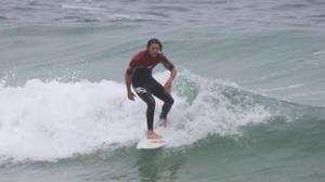 R�mulo Arantes Neto curte folga na praia